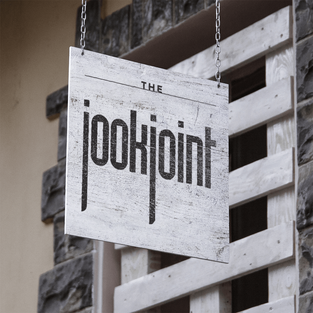 Jook Joint brand identity on hanging sign