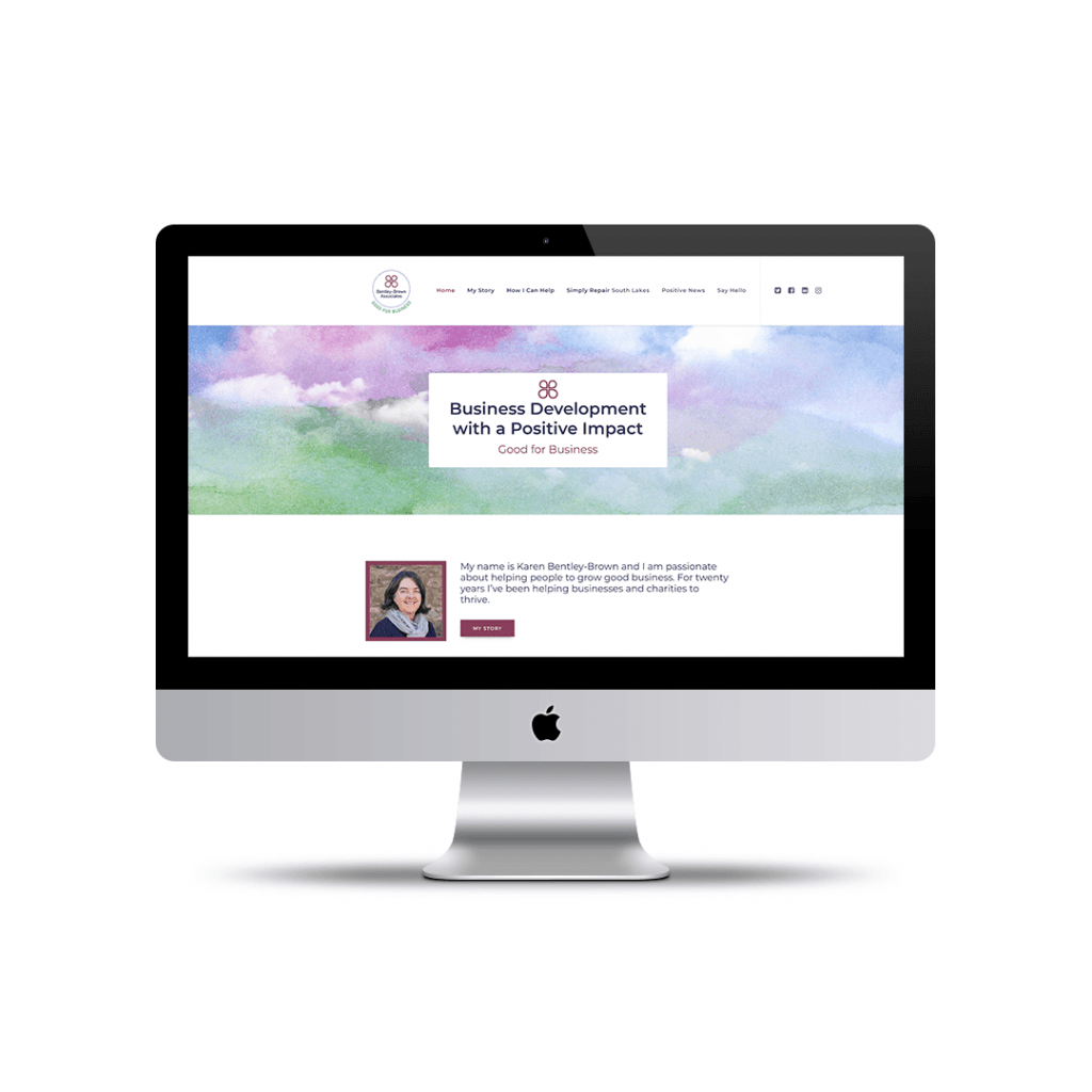 Desktop computer displaying the home page website design for Bentley-Brown Associates