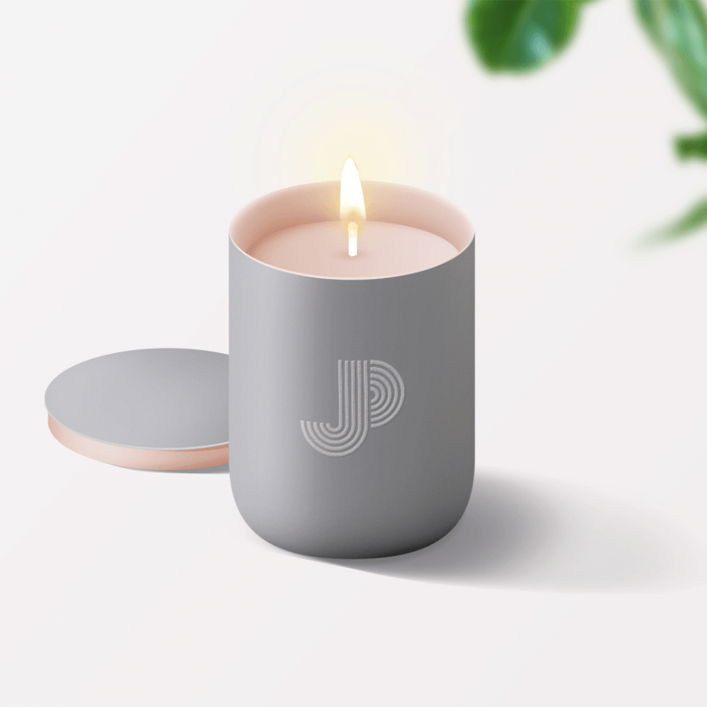 JP Massage Therapy brand identity on lit candle