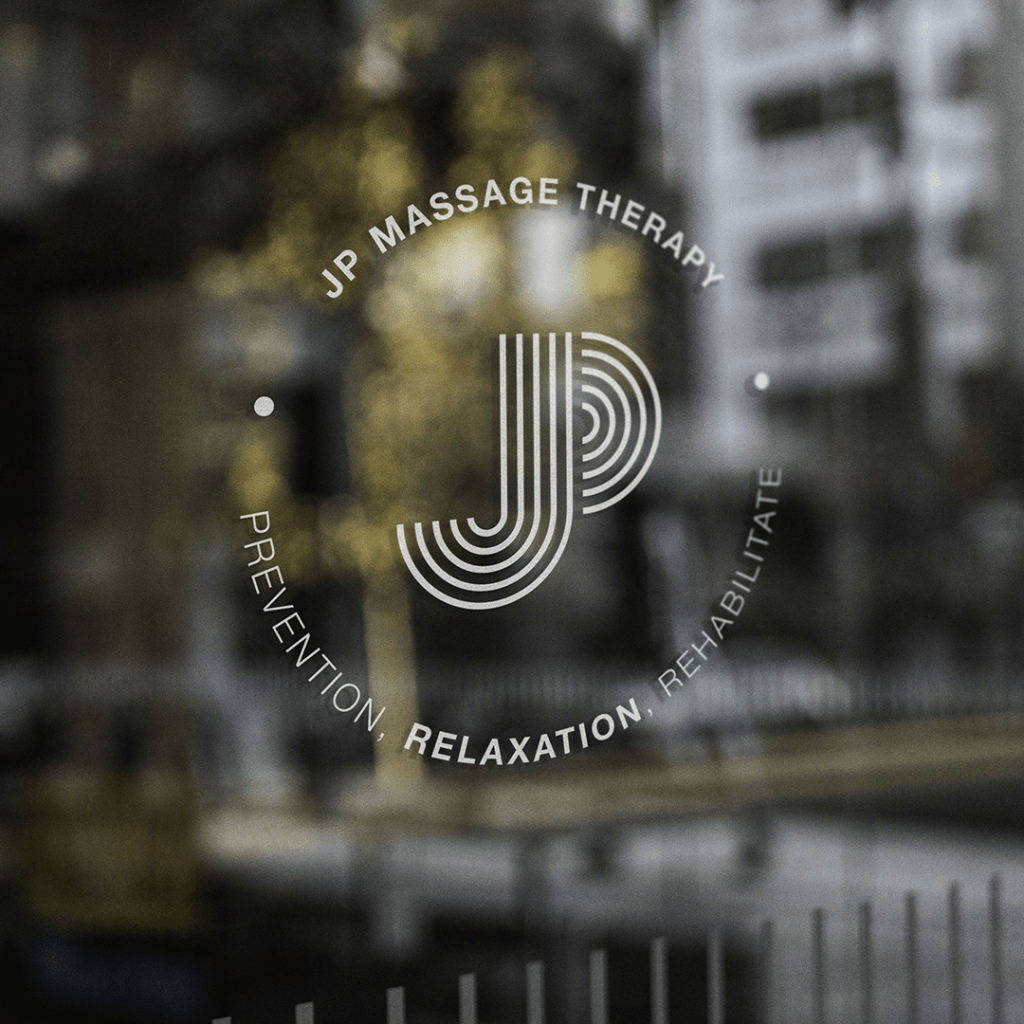 JP Massage Therapy brand identity on therapy rooms window