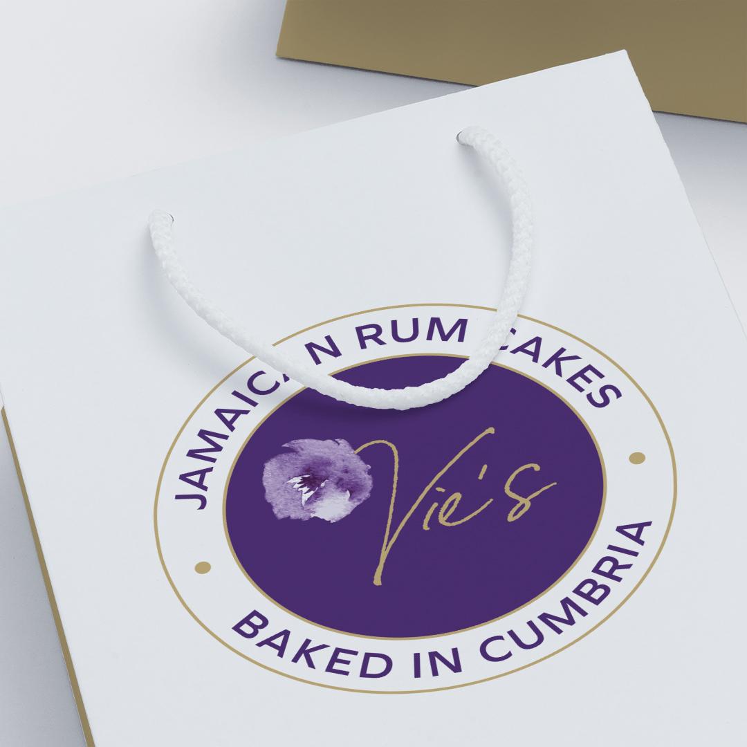 Vies Jamaican Rum Cakes logo on paper bag packaging
